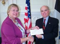 Estonian American National Council President Marju Rink-Abel presents a check of $2500 from EANC to Lee Edwards on June 28. - pics/2006/13846_2_t.jpg