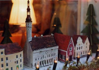 """Tilluke vanalinn – a tiny Old Town within Tallinn's Old Town, in the window of the Nukupood (doll shop) at Raekoja plats 18, the home of all things miniature and hand-made. The towered building is the Raekoda (Town Hall) and the narrow red building to its right stands in the middle of the Saiakang (""""white bread passage""""), adjacent to Pühavaimu kirik (Church of the Holy Spirit). The lower right hand window of the mini-building on the left is the one you are peering into… Photo: Riina Kindlam - pics/2007/12/18489_1_t.jpg"""