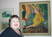 * Mai Järve oma kodus pildi taustal, mis on talle üks kallimaid: Mai on sellel 16aastane ja autoriks on tema ema Benita Vomm (1908‹2005). Foto: K.  Tensuda       - pics/2007/16524_2_t.jpg