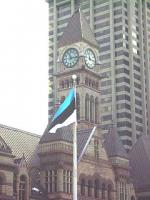 The blue, black and white flying free at Toronto's City Hall, marking Estonia's 90th anniversary of independence, with the clock tower of Old City Hall in the background.  Photo: Roland Campbell - pics/2008/02/19191_1_t.jpg