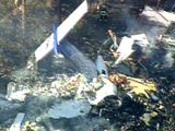 The smoldering rubble of Continental Connection Flight 3407 can be seen from the CTV News helicopter over suburban Buffalo, N.Y., Friday, Feb. 13, 2009. - pics/2009/02/22818_1.jpg
