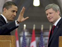 U.S. President Barack Obama waves to the media as he and Prime Minister Stephen Harper leave a joint news conference on Parliament Hill in Ottawa, Thursday, Feb. 19, 2009. (Fred Chartrand / THE CANADIAN PRESS) - pics/2009/02/22869_1.jpg