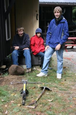 Andres Jeeger, Loucas Mell and Kristjan Naelapea take a break from jacking up and leveling the underpinnings of the sõtse tare,  sleeping quarters for Lembitu's auxiliary mothers' group. Lembitu's family approach to scouting is a key part of the group's continuing appeal sixty years after its founding. Photo: T. Kütti - pics/2009/10/25522_2_t.jpg
