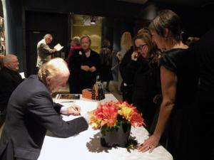 At the closing night gala of ESTDOCS10, from left Asko Kütti, author John Ralson Saul, guest speaker of the evening signing his book for Liisbet Valter-Kalm. Others ­ Katrin Otsa (in background) and Ellen Valter (on right).