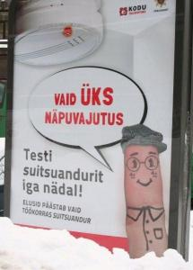 """Mr. Näpp says: """"Just one push of a button."""" (Näpuvajutus is literally """"finger push"""".) """"Test your smoke detector (suitsuandur) every week! Only a smoke detector in working order can save lives."""" This message was brought to you by the Päästeamet, the Estonian Rescue Board. Photo: Riina Kindlam - pics/2011/03/31625_1_t.jpg"""