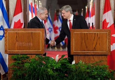 Prime Minister Stephen Harper and Benjamin Netanyahu, Prime Minister of Israel, shake hands following a joint media availability on Parliament Hill - pics/2012/03/35444_001_t.jpg
