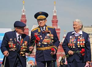 Russian WWII veterans walk on Red Square after the Victory Day parade in Moscow, 09 May 2013. Credit: EPA  - pics/2013/05/39310_001_t.jpg