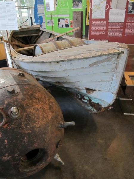 This fishing motorboat, on display at the Museum of Occupations in Tallinn, was built in the 1930s. It safely reached the island of Gotland in Sweden in the fall of 1944 with its cargo of passengers escaping Estonia ahead of the next Soviet invasion.  Next to it is a naval mine, a mere/miin. Photo: Riina Kindlam - pics/2014/11/43605_001.jpg