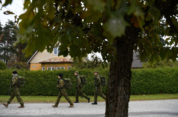 Members of the Estonian Defense League set off for a patrol competition near the town of Turi in central Estonia. The events, held nearly every weekend, are called war games, but they are not intended to be fun. Credit James Hill for The New York Times  - pics/2016/10/48607_001.jpg