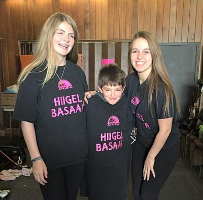 First-time volunteers at Hiigelbasaar #26: in the middle, youngest volunteer Stephane Perron, on the right footwear department whiz-kid Kariina Järve and on the left rummage sale enthusiast and Girl Guide Sylvi Oja.   - pics/2017/05/49697_001_t.jpg